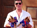 Simon Cowell with his dogs Squiddly and Diddly attending a press launch for Britain's Got Talent at LSO St Luke's in London.   PRESS ASSOCIATION Photo. Picture date: Wednesday April 9, 2014. Photo credit should read: Ian West/PA Wire