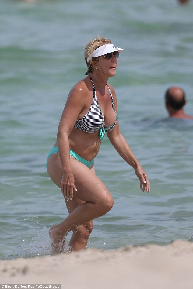 Surfs up: Vicky Gunvalson was seen enjoying a quick dip on Miami beach on Wednesday