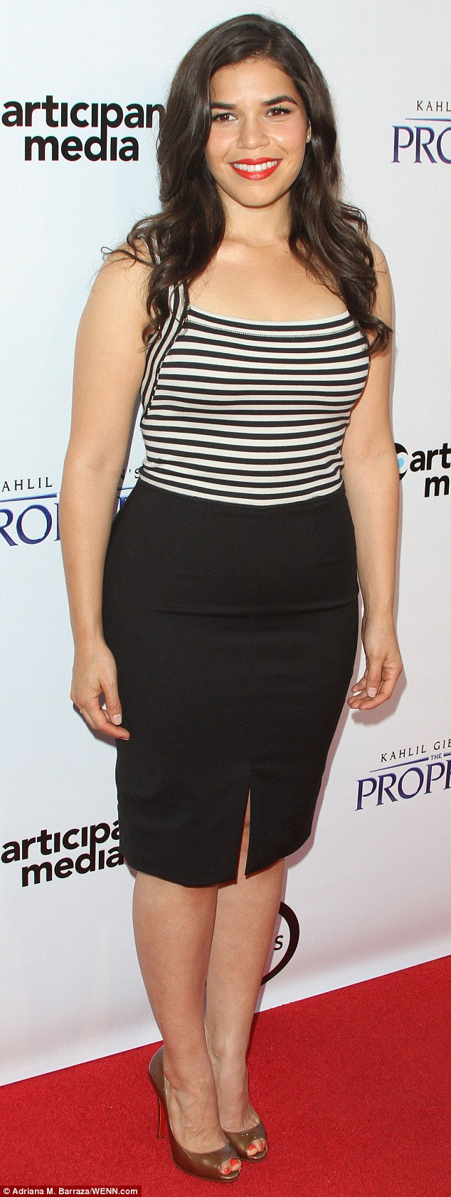 Black and white is alright: America Ferrera attended the event in a monochrome ensemble and wore a pair of beaten gold peep toe shoes
