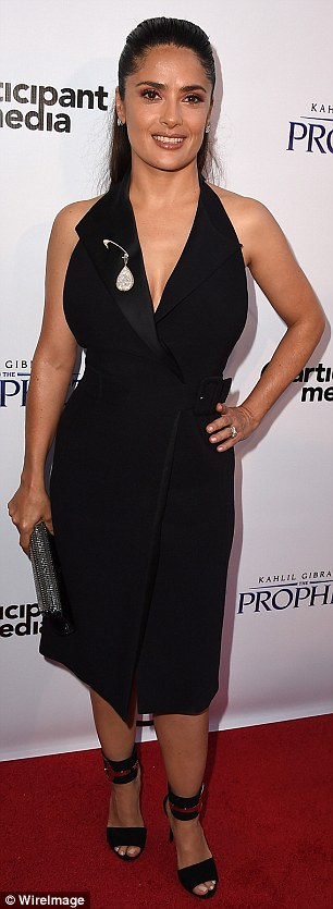 Gorgeous: Wearing a black wrap dress which featured a tuxedo style plunging neckline, she teamed her frock with a pair of sky high Gucci sandals