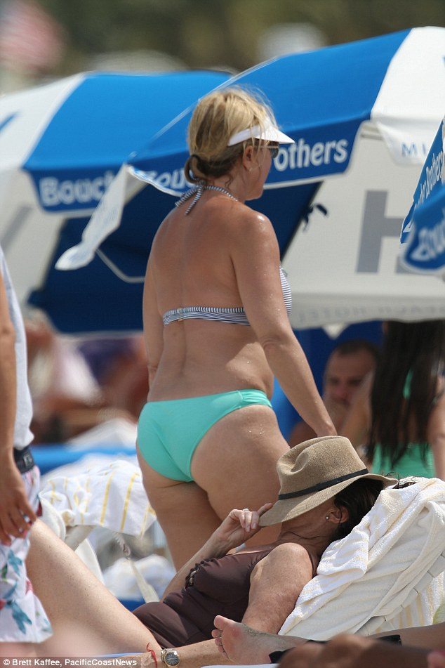 Beach bum: She showed off her derriere as she hit the sun loungers