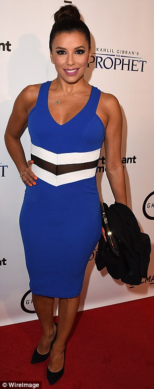 Chic: The Latina star wore a blue figure hugging frock which featured and white and black striped detail