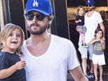 *EXCLUSIVE* Calabasas, CA - Scott Disick was seen taking his children Mason and Penelope out to dinner at their favorite local restaurant, Rosti Cafe, in Calabasas. As Scott and the children were eating dinner, two fine looking party girls walked into the restaurant, at which point Scott sat in his seat and kept interacting with his children, completely ignoring the would be distraction. Noticeably absent from the family outing, was Scott's long time partner, Kourtney Kardashian, who may have put the girls up to testing Scott's desire to be a family man, over being a party animal. Scott passed with flying colors; this time, even remembering to bring his children when he exited the restaurant.\\n\\nAKM-GSI          July 27, 2015\\n\\nTo License These Photos, Please Contact :\\n\\nSteve Ginsburg\\n(310) 505-8447\\n(323) 423-9397\\nsteve@akmgsi.com\\nsales@akmgsi.com\\n\\nor\\n\\nMaria Buda\\n(917) 242-1505\\nmbuda@akmgsi.com\\nginsburgspalyinc@gmail.com