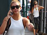 EXCLUSIVE: Hailey Baldwin spotted sipping on some juice after working out at the gym in NYC.  Hailey was spotted sipping on some juice from 'Juice Press' after working out at her local gym. Afterwards Hailey stopped by 'Edon Manner' to do a bit of shopping.  Pictured: Hailey Baldwin Ref: SPL1089533  290715   EXCLUSIVE Picture by: Tom Meinelt / Splash News  Splash News and Pictures Los Angeles: 310-821-2666 New York: 212-619-2666 London: 870-934-2666 photodesk@splashnews.com
