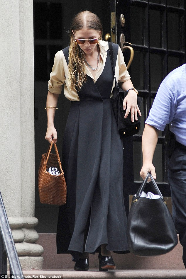 Bordering on Pilgrim: Ashley Olsen showcased her eccentric, ultra-conservative style after emerging from her Manhattan brownstone with her hair still damp on Thursday