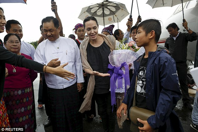 Proud mum: Angelina feels a particular affinity to south east Asia because her son, Pax, who is accompanying her, is from the region