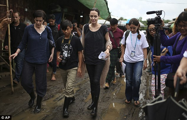 Angelina and Pax, who is originally from Vietnam and was adopted by his mother and husband Brad Pitt, wore Wellies as they met the children displaced by the conflict