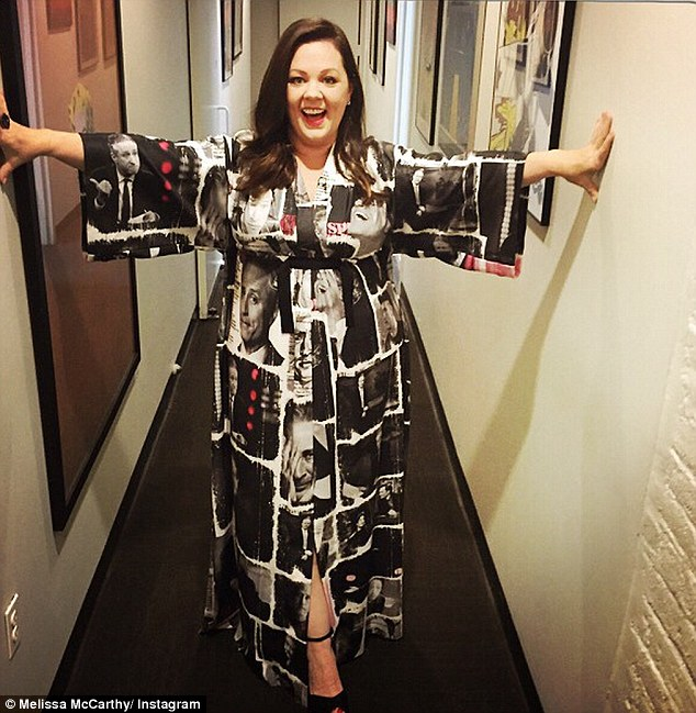 Another work of art: Melissa wore this silk kimono covered in the face of Jon Stewart on to the talk show host's show last month