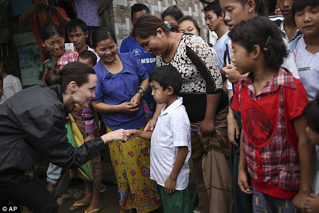 Touching moments: Jolie visited as a special envoy for the UN High Commissioner for Refugees, to visit as she tried to highlight the plight of those displaced and improve human rights in the country
