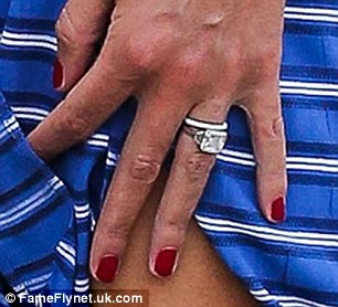 One expensive finger: Nicky's diamond engagement ring - which is thought to be worth around £250,000 - sat perfectly above her glittering wedding band