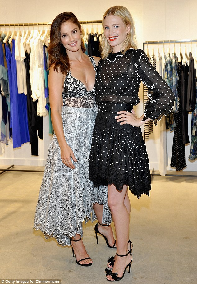 Taking the plunge: Minka Kelly also opted for a daring outfit, choosing a plunging top for the fashion event