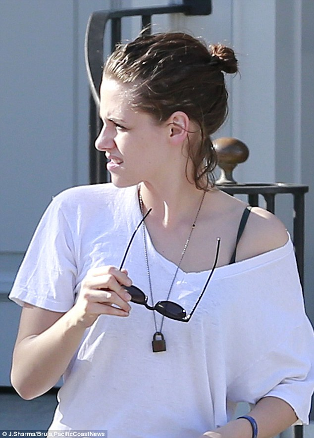 Hassle-free look: Kristen removed her sunglasses and showed off more of that hurried hairdo