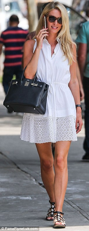 Bridal white: Earlier in the day, Nicky was spotted out and about wearing a pretty broderie anglaise-hem dress