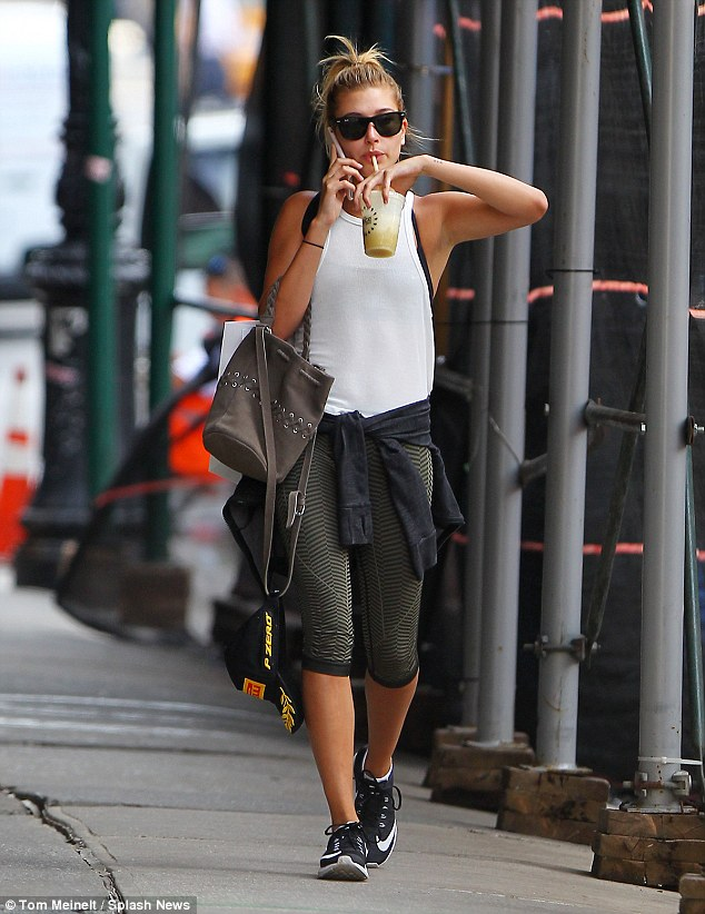 Gym bunny: The 18-year-old was seen making her way to Juice Press in her workout gear as she did spot of shopping at Eden Manner