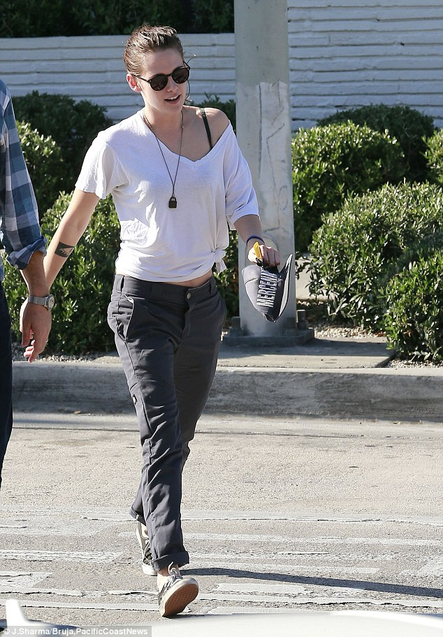 Rebel with a cause: Kristen Stewart showed her independent fashion streak while out to lunch in Los Angeles on Wednesday with a male friend