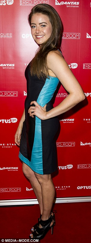 Stylish: April Rose Pengilly - the model daughter of INXS rocker Kirk Pengilly - stunned in a sleeveless two-tone dress