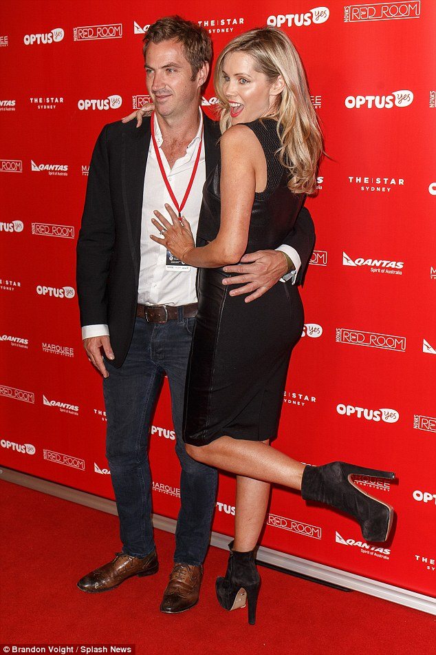 Kicked up her heels! The blonde was accompanied by her husbandTony Thomas
