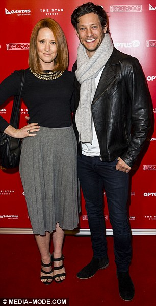 Loved up: Former Australian Idol star Rob Mills cuddled up to his actress girlfriendEllen Simpson on the red carpet and laid a kiss on her head