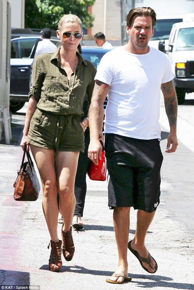 Stylish outing: Sean dressed casually for the lunch date in a simple T-shirt and shorts, while Stephanie looked fashion forward in her ensemble