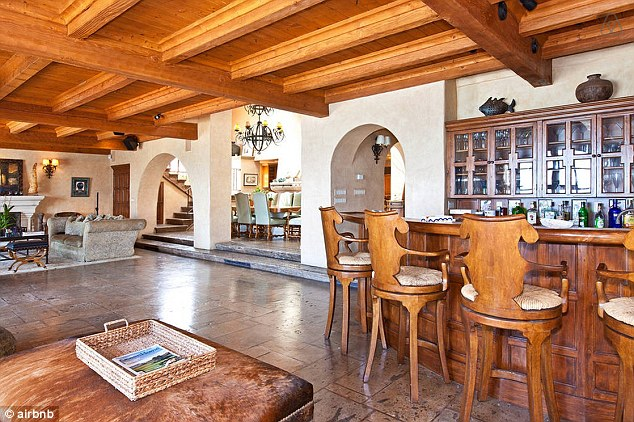 Spacious: The four-bedroom home has an open plan living and dining area with high ceilings