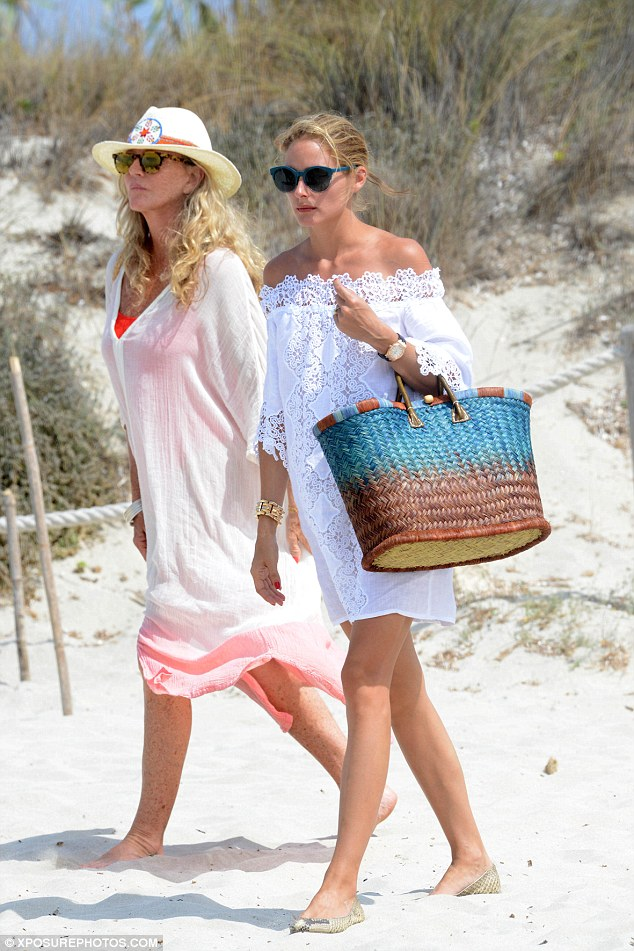 Beach ready; The beauty looked exquisite in a white beach cover up and croc print loafers