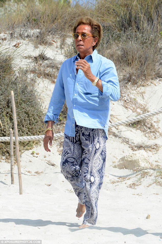 Fashion fan: The fashion designer was similarly well turned out in patterned trousers