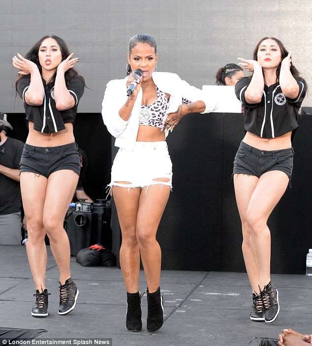 Leggy lady: Showing off lots of leg in a pair of ripped, white hotpants, the 33-year-old star was sure to turn some heads as she performed some of her biggest tracks