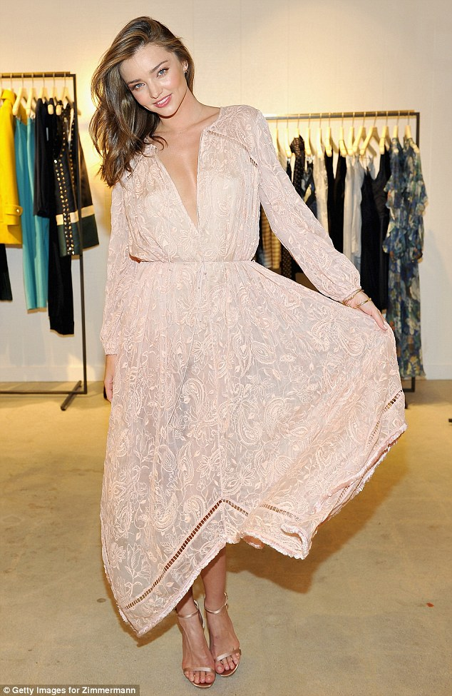 All eyes on her: Miranda Kerr stunned at the Zimmermann Melrose Place flagship store opening on Wednesday night in Los Angeles, California
