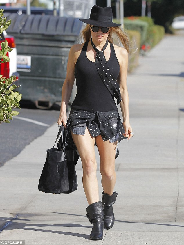 The Woman in Black! Fergie hoped to go incognito in an all-black outfit as she was spotted leaving a recording studio in Los Angeles, California, on Wednesday