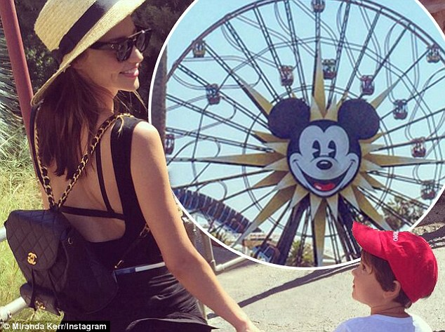 Working mum: Earlier this week she was spotted taking son Orlando, four, to Disneyland