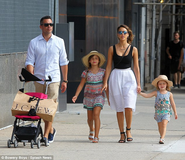 The brood: Jessica also gushed over her husband Cash (L) in the interview, calling him a 'great dad'