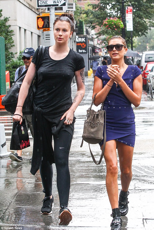 Soaked: Ireland Baldwin got caught in a downpour on Thursday during an outing with cousin Hailey Baldwin