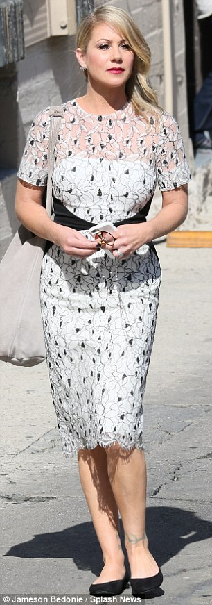 Winning outfit: The Married... With Children star wore a black and white floral print dress to the taping