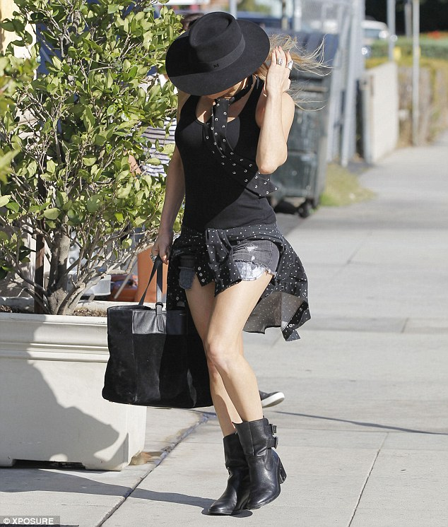 Finishing touches: The camera-shy singer hid her face behind a black fedora hat as she emerged from the studio after working on perfecting her new album which is due for release this year