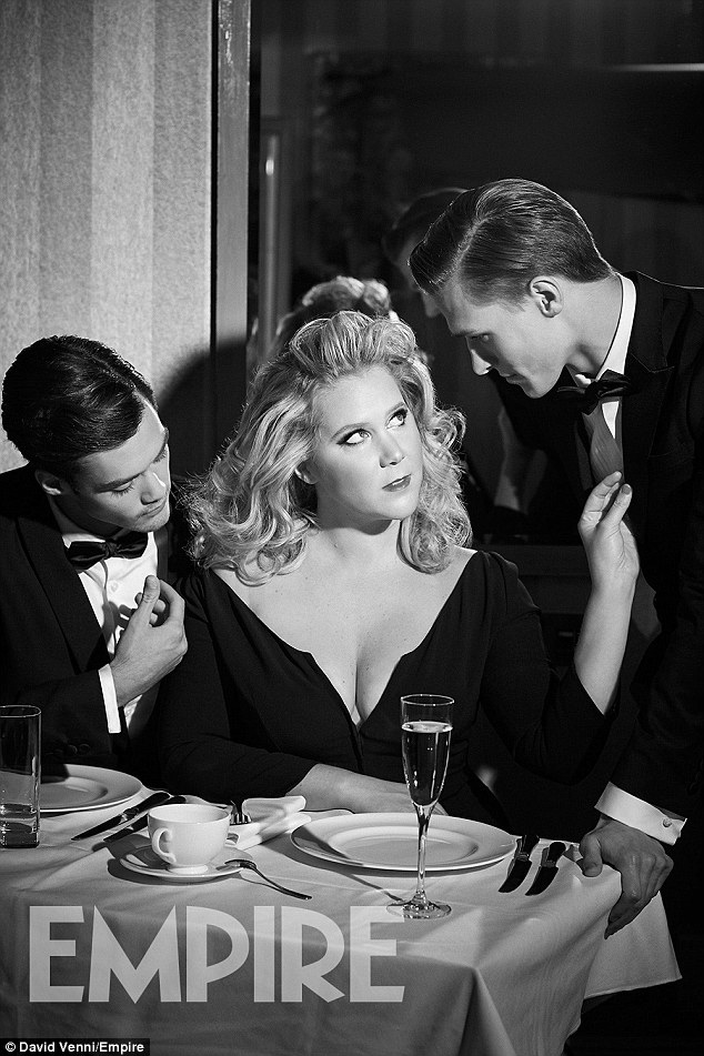 Breakout role: The Trainwreck star pays homage to Madonna in the fun spread with one image seeing the star in a plunging navy dress as she charms two gentleman in a restaurant