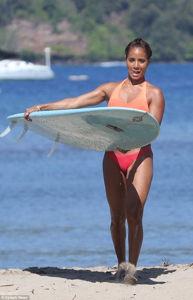 Surf's up: The mother-of-two highlighted her taut figure in a colourful two-piece and accessorised with gold bangles