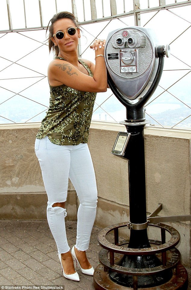 Strike a pose: Mel B put on her best superstar pose while showing off some skin in those ripped jeans
