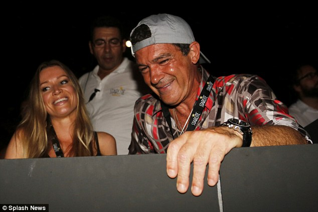 Rolling back the years: Antonio Banderas, 54, looked to be on fine-form as he and his girlfriend Nicole Kimpel, 34, enjoyed the classic pop stylings of Lionel Richie at an open-air gig in Marbella, on Wednesday