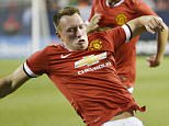 Image:  38517230    Manchester United defender Phil Jones (L) and Paris Saint-Germain defender Maxwell go for the ball during the first half of their match in the 2015 International Champions Cup on July 29, 2015 in Chicago. Paris Saint-Germain defeated Manchester United 2-0.    PHOTOGRAPH BY UPI /Landov / Barcroft Media UK Office, London. T +44 845 370 2233 W www.barcroftmedia.com USA Office, New York City. T +1 212 796 2458 W www.barcroftusa.com Indian Office, Delhi. T +91 11 4053 2429 W www.barcroftindia.com