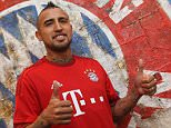 MUNICH, GERMANY - JULY 28:  Chilean midfielder Arturo Vidal poses for photographer after he signed his contract with FC Bayern Munich on July 28, 2015 in Munich, Germany.  (Photo by A. Beier/Getty Images for FC Bayern)