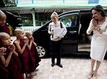 Actress Angelina Jolie, right, pays respect to Buddhist novice monks upon arrival at a monastery to meet with religious leaders from Myanmar Interfaith Group Friday, July 31, 2015, in Yangon, Myanmar. The Hollywood actress arrived in Myanmar, for her first visit to the country Thursday to learn more about the situation in the country and encourage efforts to build a peaceful and inclusive future for all its people. During the four-day visit she will carry out engagements in her capacity as co-founder of the Preventing Sexual Violence Initiative, and as UNHCR special envoy will carry out field visits to displaced people in Myanmarís conflict-affected states. (AP Photo/Khin Maung Win)