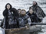 """This image released by HBO shows Kit Harington as Jon Snow, left, in a scene from """"Game of Thrones."""" HBO programming chief Michael Lombardo said Thursday, July 30, 2015, that the drama series' producers are leaning toward three more seasons after the just-concluded season five. Lombardo told a TV criticsí meeting in Beverly Hills, Calif., that he hopes that theyíll change their minds, but that appeared to be the intent. (Helen Sloan/HBO via AP)"""