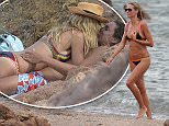 Heidi Klum enjoying a bath in the sea of Sardinia\n\nPictured: Heidi Klum\nRef: SPL1091028  300715  \nPicture by: Splash News\n\nSplash News and Pictures\nLos Angeles: 310-821-2666\nNew York: 212-619-2666\nLondon: 870-934-2666\nphotodesk@splashnews.com\n