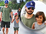 Woodland Hills, CA - Scott Disick takes his son Mason shopping at Target in Woodland Hills, California. Scott walked hand in hand with his boy and even broke a small smile for the cameras as the two walked inside.\nAKM-GSI        July  30, 2015\nTo License These Photos, Please Contact :\nSteve Ginsburg\n(310) 505-8447\n(323) 423-9397\nsteve@akmgsi.com\nsales@akmgsi.com\nor\nMaria Buda\n(917) 242-1505\nmbuda@akmgsi.com\nginsburgspalyinc@gmail.com
