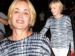 Iconic actress Sharon Stone returned to LA in a blue and white zebra-striped top, with white pants, her hair cut short, on Thursday, July 30, 2015 X17online.com