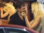 ***STRICTLY NO WEB***\n***MINIMUM SET REPRO FEE 1500 POUNDS***\nEXCLUSIVE: The Kills frontman Jamie Hince gets friendly with a blonde fan after his show at the El Rey in Los Angeles. Jamie chatted to the girl outside the venue before escorting her and her male friend in his limo to the after party at the Kibitz Room. The party continued until the bar closed at 2am where the group chatted outside for 45 minutes. Also in attendance was The Kills bandmate Alison Mosshart, Arctic Monkeys singer Alex Turner, his indie pal Miles Kane and Patrick Carney of The Black Keys.