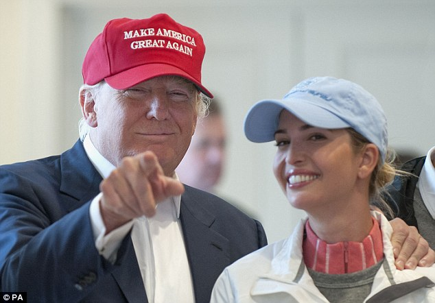 New look: Donald Trump has a new red version of his Make America Great Again hat. The white one has sold out at his Trump Towers store