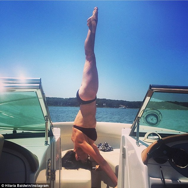 Deja-vu: The beauty's last headstand snap, shared two weeks ago, showed her trim waist and was captioned: 'Mommy and Daddy are heading out for 2.5 hours/3.5 week.#ShrinkingBaldwinBabyBump'