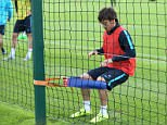 David Silva (left) uses the special elasticated knee braces to improve the strength of the muscles around his joint