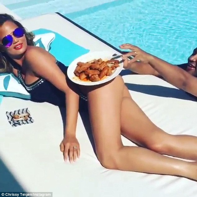 Such a tease! Her husband John Legend reached for the dish and the tasty treat was pulled out of reach by Chrissy's gluteus maximus
